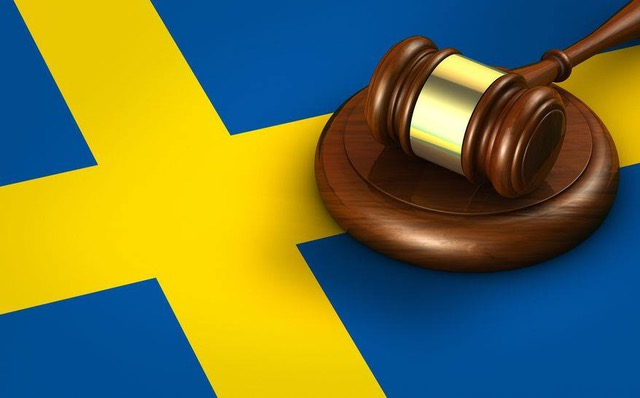 Sweden law, legal system and justice concept with a 3D rendering of a gavel on Swedish flag.